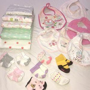 Baby bibs, socks, receiving blankets